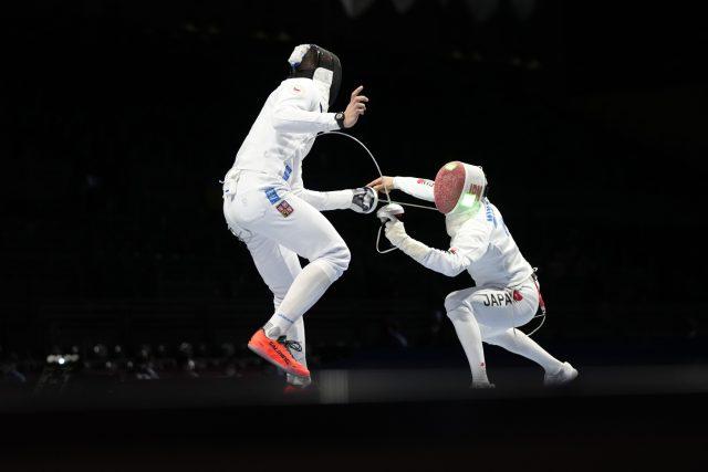 Jakub Jurka  (vlevo) v souboji s Japoncem Minobem. | foto: Hassan Ammar,  ČTK / AP